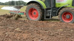 Tractor closeup plow field rural farm building house Stock Footage