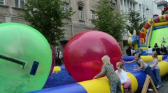 Children zorb ball swim pool gediminas prospect event Stock Footage