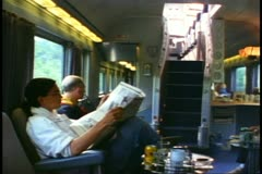 "People in the Park Car lounge reading newspapers on ""The Canadian"" Stock Footage"