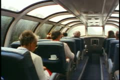 "Observation Dome car on ""The Canadian"" train, wide shot, raining outside Stock Footage"
