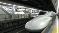 Stock Video Footage of Arriving bullet train at Tokyo station, high speed travel in Japan