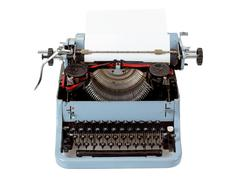 Retro uncovered blue typewriter Stock Photos