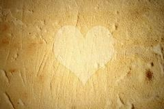Heart on the wall background Stock Illustration