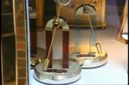Toronto, 1990, Eaton Center, clocks in window, swinging pendulums Stock Footage
