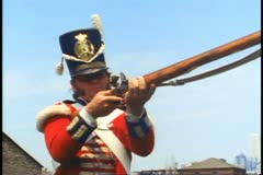 Man in military uniform demonstrates musket, Fort York, Toronto Stock Footage