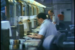 Interior of Union Station, Toronto, railroad ticket agent selling train tickets - stock footage