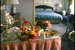 Breakfast in luxury hotel suite, trolley arrives with server Stock Footage