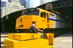 """The Canadian"" train, locomotives in Union Station, Toronto, a cart passes Stock Footage"