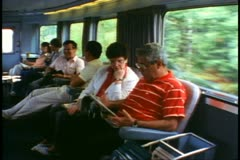"""People in the Park Car reading and talking onboard """"The Canadian"""" train Stock Footage"""