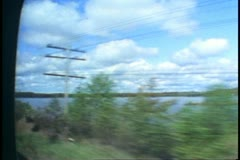 POV out train window, passing lake and pine trees, Ontario, Canada Stock Footage