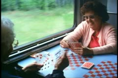 "People in Cafe car playing cards on ""The Canadian"" train Stock Footage"