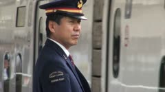 Shinkansen station staff, crew, high speed train, arrival arrive, uniform, Japan Stock Footage