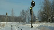Railroad worker  with cell phone on signal beacons pole Stock Footage