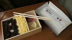 Shinkansen meal, food, handheld tilt, carriage, inside, Japan Stock Footage