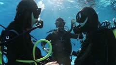 Scuba diver underwater, shows signs. Stock Footage