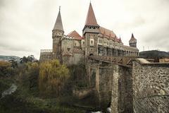 medieval castle, with bridge & moat - stock photo