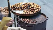 Stock Video Footage of hot chestnuts sellers
