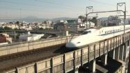 Stock Video Footage of Shinkansen, bullet train, Kyoto skyline, high speed, modern, Japan transport