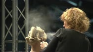 Stock Video Footage of Hair model is sprayed with hairspray.