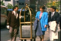 Bellman escorts couple and bags from Royal York Hotel to Union Station Stock Footage