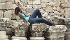Woman poses resting on  pedestal Stock Footage