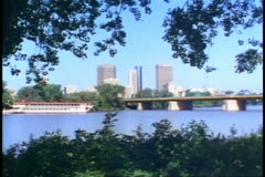 Winnipeg, Canada, skyline, river foreground, framed in trees, wide shot Stock Footage