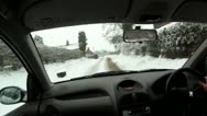 Driving through snow on road - pov driving shot Stock Footage