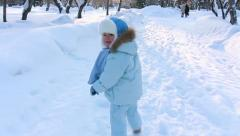 Child running through alley in Winter park Stock Footage