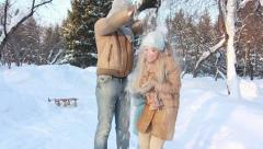 Family fun in a winter park Stock Footage