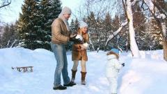Young family throw up snow Stock Footage