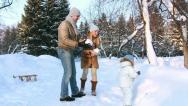 Stock Video Footage of Young family throw up snow