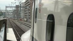 Stock Video Footage of Japan, Shinkansen bullet train leaves platform, high speed accelerate