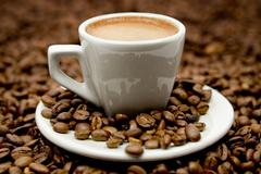 Espresso on Coffee Beans - stock photo