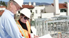 Construction Boss Gives Instructions to Worker Stock Footage