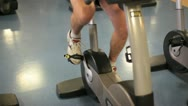 Stock Video Footage of In a gym working out cycling on a hometrainer