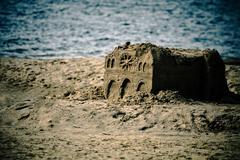Artistic castle on seaside Stock Photos