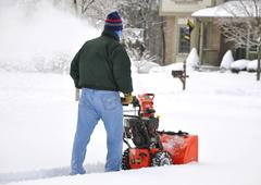 Snow blowing - stock photo