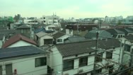 Stock Video Footage of Shinkansen rides through residential area in Japan