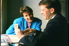 A couple examines railroad tickets in room at Royal York Hotel, Toronto Stock Footage