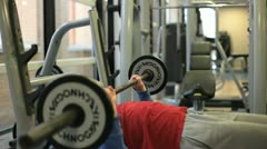 In a gym working out lifting weights Stock Footage