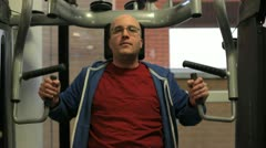 In a gym working out a man is training biceps Stock Footage