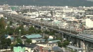 Stock Video Footage of Shinkansen, high speed, urban scene, city, skyline, suburbs, Japan