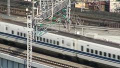 Shinkansen passing, Japan, high speed travel, railways, tracks, transport Stock Footage