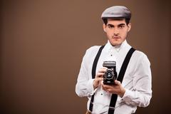 Antique photographer outfit and dslr Stock Photos