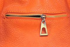 Orange leather with zipper Stock Photos