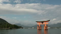 Blue skies over floating torii gate in Japan Stock Footage