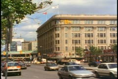 Hudson's Bay Co. Store, wide shot, traffic, Winnipeg, Canada, 1990 Stock Footage