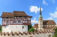 Zug castle and st. oswald church, switzerland Stock Photos