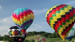 Hot air balloons lifting off - stock footage