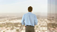 Rearview of businessman raising his arms in excitement Stock Footage